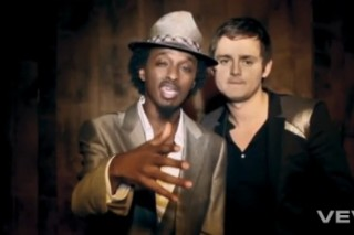 "Keane Board The 'Night Train' With K'Naan On New EP, Video ""Stop For A Minute"""