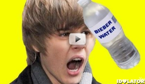 Justin Bieber hit by water bottle on stage in head