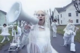 "Kerli Raves In The Woods In Her ""Army Of Love"" Video"