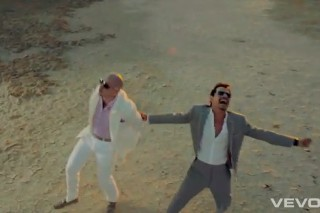 "Pitbull And Marc Anthony Hit The Desert In Their ""Rain Over Me"" Video"