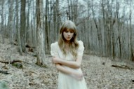 "Taylor Swift Feels ""Safe & Sound"" In The Woods In New Video"