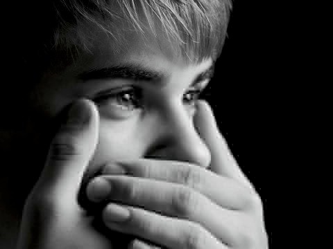 Justin Bieber hands mouth black and white