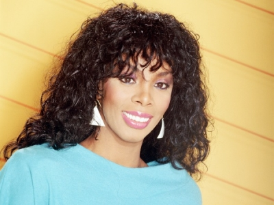 Donna Summer '80s promo photo earrings blue shirt