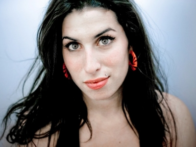 Amy Winehouse promo pic blue background
