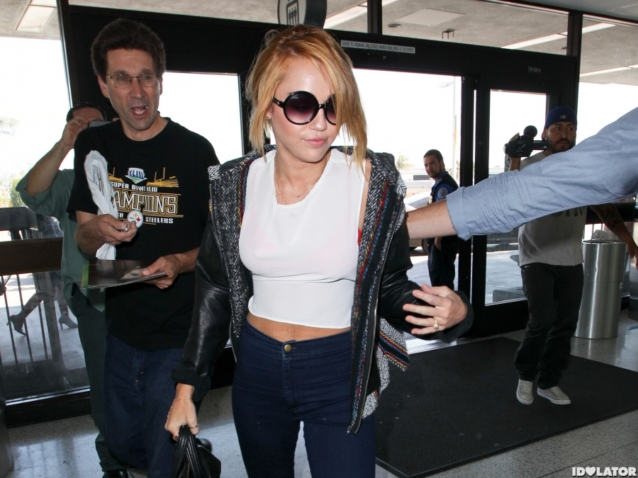 Miley Cyrus Shows Off Her Engagement Ring At LAX