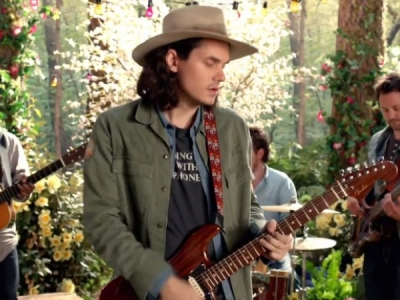 "John Mayer Is A Travelin' Man In His ""Queen Of California"" Video"