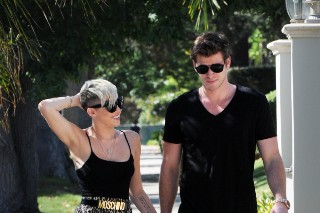 Miley Cyrus & Liam Hemsworth Take A Romantic Walk