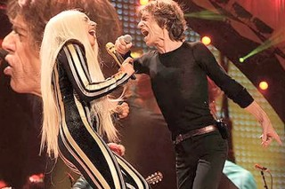 Lady Gaga Takes Shelter With Rolling Stones At New Jersey Concert: Watch