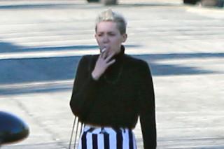 Miley Cyrus Enjoys A Post-Christmas Cigarette