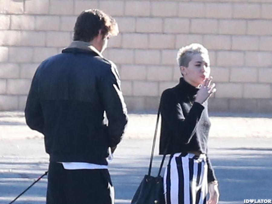 Miley Cyrus Takes A Cigarette Break