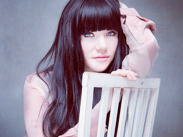 Carly Rae Jepsen promo shot chair