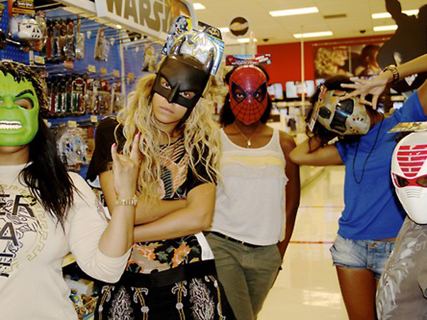 Beyonce and friends wearing superhero masks