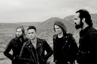 "The Killers' ""Just Another Girl"": Listen To The New 'Direct Hits' Song"