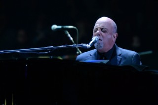 "Billy Joel Forgets The Lyrics To ""We Didn't Start The Fire"" Then Slams The Song: Watch"