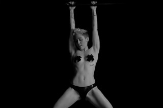 "Miley Cyrus Strips Naked For Bondage-Themed ""Tongue Tied"" Projection: Watch The NSFW Video"