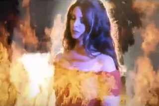 "Lana Del Rey's ""West Coast"" Video: Watch Her Frolic In Sand And Fire"