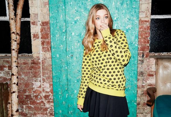 Becky Hill yellow jumper