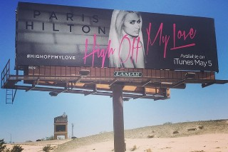 "From Nude Pics To Roadside Billboards, Paris Hilton's ""High Off My Love"" Promo Game Is Next Level"