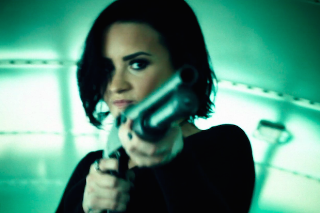 "Demi Lovato Kicks Ass In Action-Packed ""Confident"" Video: Watch"
