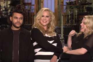 The Weeknd Looks Completely Out Of Place In These 'SNL' Promos With Amy Schumer: Watch