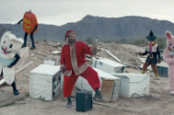 "The Killers Get Down With Santa Claus In Their ""Dirt Sledding"" Video: Watch"