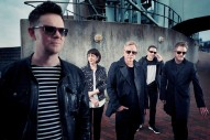 "New Order Travel To 1980s Germany For ""Singularity"" Video: Watch"