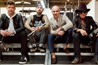 """Pitbull Features Robin Thicke, Joe Perry And Travis Barker In """"Bad Man"""": Listen"""