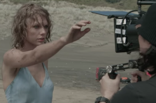 "Taylor Swift Goes Behind The Scenes Of Her ""Out Of The Woods"" Video: Watch"