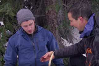 Nick Jonas Looks Reluctant To Eat Bird Guts In This Teaser For His 'Running Wild With Bear Grylls' Episode