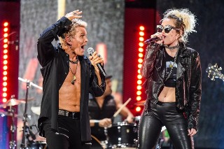 "Miley Cyrus Joins Billy Idol For ""Rebel Yell"" At iHeartFestival: Watch"